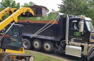 Green & Black dump truck