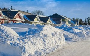 snow plowed in front of houses