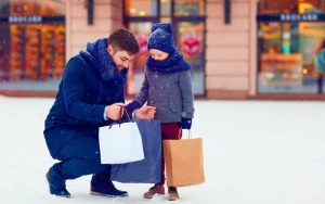 dad and kid shopping in the snow