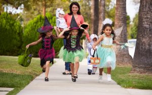 mom and kids in costumes