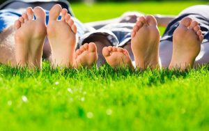 people laying down in grass