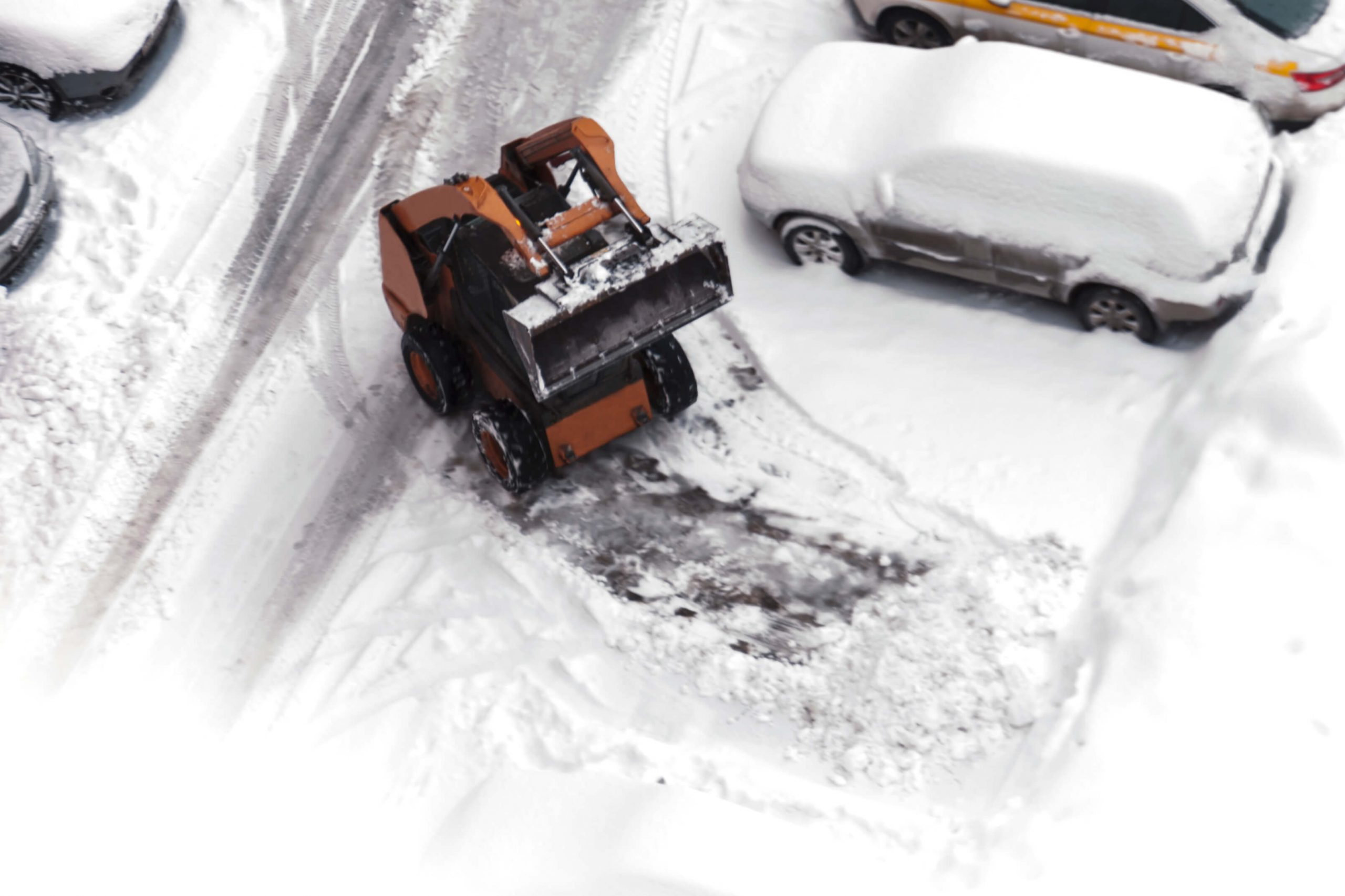 plowing snow covered parking lot